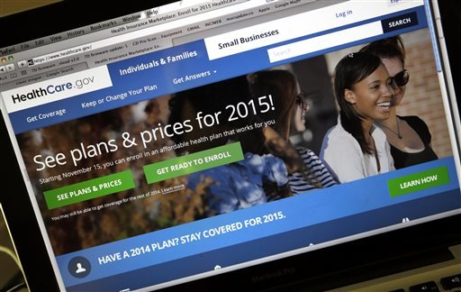 In this Nov. 12, 2014, file photo, the HealthCare.gov website, where people can buy health insurance, is shown on a laptop screen in Portland, Ore. A government data warehouse stores information forever on millions of consumers seeking coverage under Pres