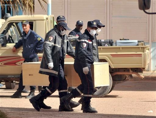 In this Jan. 21, 2013 file photo, Algerian firemen carry a coffin containing the body of a person killed during the gas facility hostage situation at the morgue in Ain Amenas, Algeria. The U.S. said the military launched an airstrike Saturday, June 13, 20