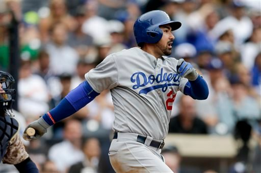 Los Angeles Dodgers' Adrian Gonzalez hits a two-RBI single against the San Diego Padres during the twelfth inning of a baseball game Sunday, June 14, 2015, in San Diego. The Dodgers won, 4-2. (AP Photo/Gregory Bull)