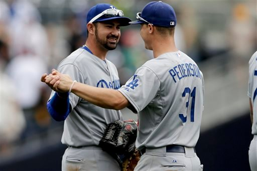Los Angeles Dodgers first baseman Adrian Gonzalez, left, and teammate center fielder Joc Pederson celebrate after defeating the San Diego Padres in a baseball game Sunday, June 14, 2015, in San Diego. The Dodgers won 4-2. (AP Photo/Gregory Bull)