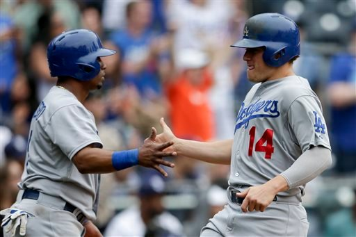 Los Angeles Dodgers' Enrique Hernandez (14) greets teammate Alberto Callaspo after both scored off a single by Adrian Gonzalez against the San Diego Padres during the twelfth inning of a baseball game Sunday, June 14, 2015, in San Diego. (AP Photo/Gregory