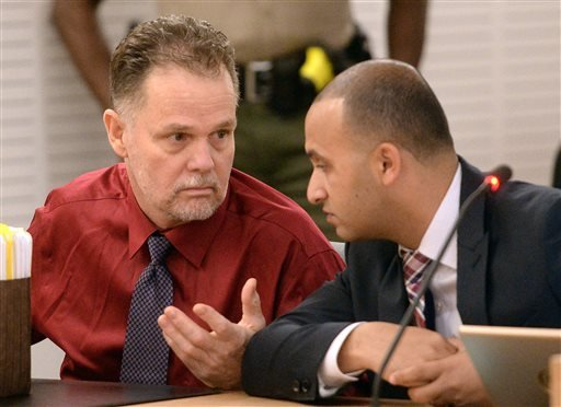 "In this May 22, 2015 file photo, Charles ""Chase"" Merritt, left, speaks to his attorney Jimmy Mettias during a hearing in San Bernardino Justice Center court in San Bernardino, Calif. Merritt, has a scheduled preliminary hearing Monday, June 15, 2015, on c"