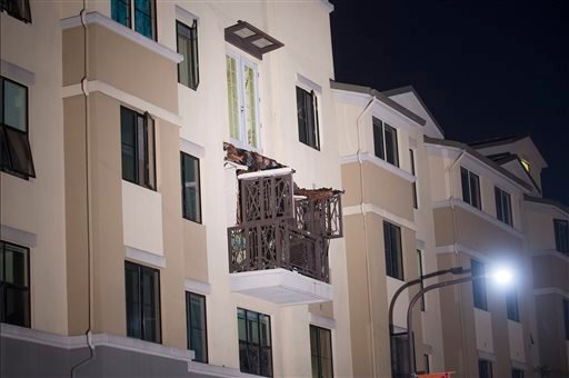 A fourth floor balcony rests on the balcony below after collapsing at the Library Gardens apartment complex in Berkeley, Calif., early Tuesday, June 16, 2015. Berkeley police say several people are dead and others injured after the balcony fell shortly be