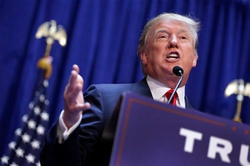 Developer Donald Trump gestures as he announces that he seek the Republican nomination for president, Tuesday, June 16, 2015, in the lobby of Trump Tower in New York. (AP Photo/Richard Drew)
