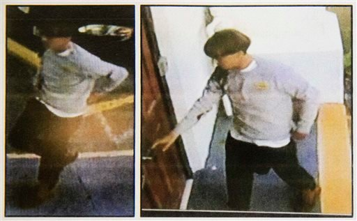 Images on a flier provided to media, Thursday, June 18, 2015, by the Charleston Police Department show surveillance footage of a suspect wanted in connection with a shooting at Emanuel AME Church. (Courtesy:Charleston Police Department via AP)