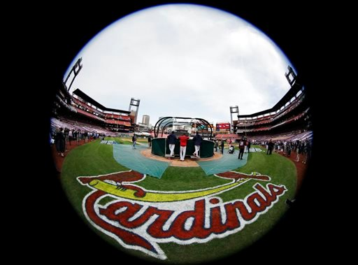 In this Oct. 28, 2015, file photo, taken with a fisheye lens, St. Louis Cardinals take batting practice before Game 5 of baseball's World Series against the Boston Red Sox in St. Louis.