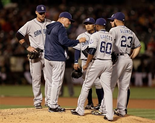 San Diego Padres manager Pat Murphy, second from left, hands the ball to pitcher Frank Garces (60) during a baseball game against the Oakland Athletics on Wednesday, June 17, 2015, in Oakland, Calif.