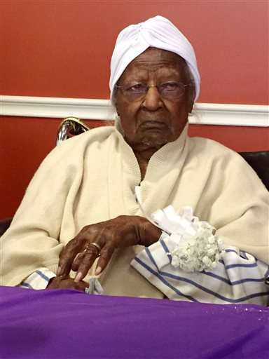 Thursday, May 21, 2015 file photo: Jeralean Talley, born on May 23, 1899, is honored at the Inkster, Mich. district office of the Michigan Department of Health & Human Services. (Elisha Anderson/Detroit Free Press via AP, File)