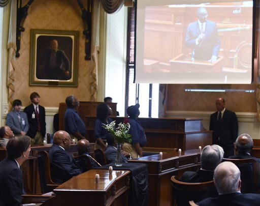 Members of the senate watch a tribute video to state Sen. Clementa Pinckney June 18, 2015, at the Statehouse in Columbia, S.C. (AP Photo/Rainier Ehrhardt)