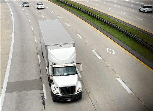 A truck heads eastbound on Rt 50 in Bowie, Md., Friday, June 19, 2015. The Obama administration on Friday proposed tougher mileage standards for medium and heavy-duty trucks, the latest move by President Barack Obama in his second-term drive to reduce pol