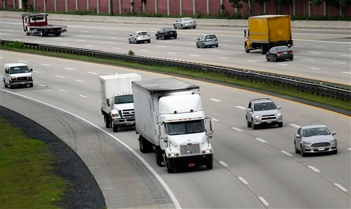 Trucks head eastbound on Rt 50 in Bowie, Md., Friday, June 19, 2015. The Obama administration on Friday proposed tougher mileage standards for medium and heavy-duty trucks, the latest move by President Barack Obama in his second-term drive to reduce pollu