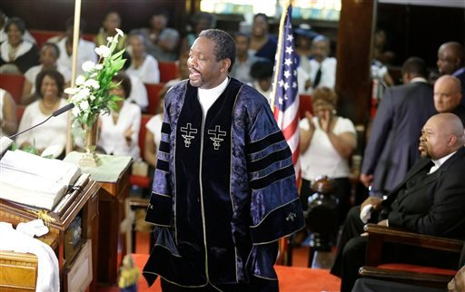 The Rev. Norvel Goff speaks during a service at the Emanuel A.M.E. Church four days after a mass shooting that claimed the lives of it's pastor and eight others on Sunday, June 21, 2015, in Charleston, S.C. (AP Photo/David Goldman, Pool)