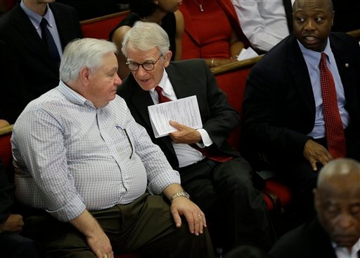 North Charleston Mayor R. Keith Summey, left, and Charleston Mayor Joseph P. Riley, Jr. talk at the Emanuel A.M.E. Church four days after a mass shooting that claimed the lives of it's pastor and eight others on Sunday, June 21, 2015, in Charleston, S.C.