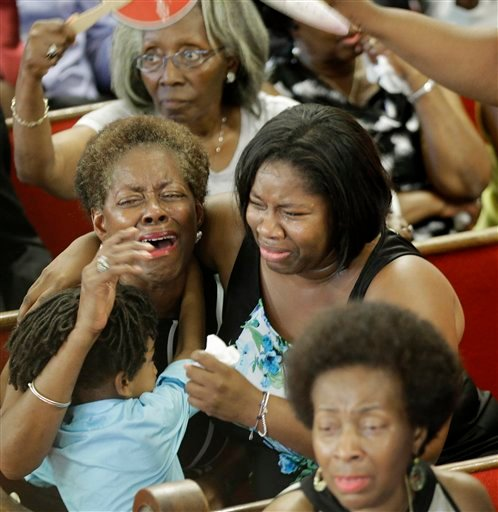 Parishioners pray and weep during services at the Emanuel A.M.E. Church Sunday, June 21, 2015, in Charleston, S.C., four days after a mass shooting that claimed the lives of it's pastor and eight others. (AP Photo/David Goldman, Pool)