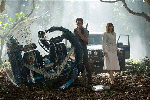 "This photo provided by Universal Pictures shows, Chris Pratt, left, and Bryce Dallas Howard in a scene from the film, ""Jurassic World,"" directed by Colin Trevorrow, in the next installment of Steven Spielberg's groundbreaking ""Jurassic Park"" series. The 3"