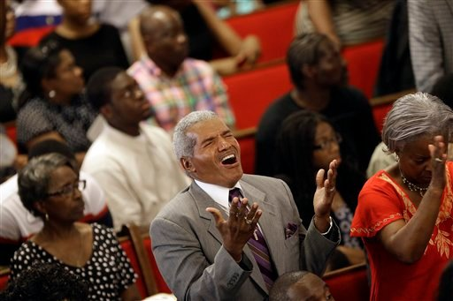 Parishioners sing at the Emanuel A.M.E. Church four days after a mass shooting that claimed the lives of it's pastor and eight others on Sunday, June 21, 2015, in Charleston, S.C. (AP Photo/David Goldman, Pool)
