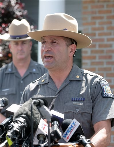 State Police Maj. Michael J. Cerretto talks to the media during a news conference after a possible sighting of the two murder convicts who escaped from a northern New York prison two weeks ago, Sunday June 21, 2015, in Amity, N.Y. (AP Photo/Gary Wiepert)