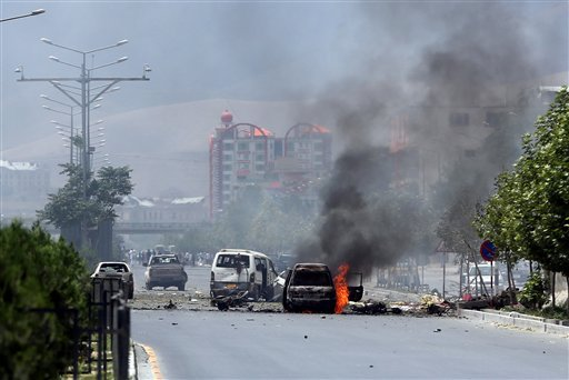 Fire and smokes rise at the site of a suicide attack during clashes with Taliban fighters in front of the Parliament, in Kabul, Afghanistan, Monday, June 22, 2015. The Taliban launched a complex attack on the Afghan parliament Monday, with a suicide car b