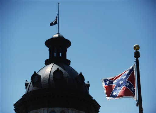 In a Friday, June 19, 2015 file photo, the Confederate flag flies near the South Carolina Statehouse, in Columbia, S.C. For 15 years, South Carolina lawmakers refused to consider removing the Confederate flag from Statehouse grounds, but opinions changed