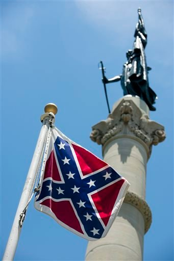A Confederate flag flies next to the Alabama Confederate Memorial on the grounds of the Alabama Capitol building in Montgomery, Ala., Monday, June 22, 2015. (Albert Cesare/The Montgomery Advertiser via AP)