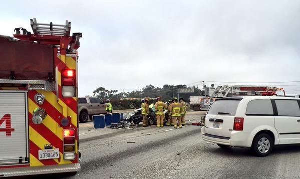 Firefighters use Jaws of Life, after fatal crash on I-5 northbound at Via De La Valle morning of Wednesday, June 24.. Photo courtesy: @GeneCBS8