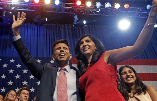 Louisiana Gov. Bobby Jindal waves to the crowd with his wife Supriya Jindal after he announced his candidacy for president in Kenner, La., Wednesday, June 24, 2015. (AP Photo/Gerald Herbert)
