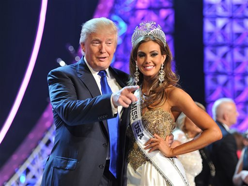 In this June 16, 2013 file photo, Donald Trump, left, and Miss Connecticut USA Erin Brady pose onstage after Brady won the 2013 Miss USA pageant in Las Vegas, Nev.
