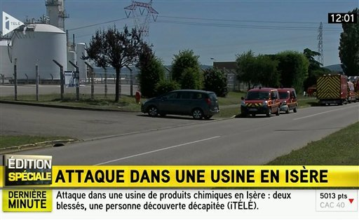 Screen grab taken from video provided by I Tele: emergency services at the scene outside a factory where a man was allegedly beheaded, in Saint-Quentin-Fallavier, France June 26, 2015. (I Tele via AP)