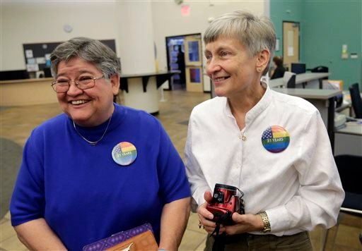 Carmelita Cabello, left, and her partner of 31 year, Jaque Roberts, right, arrive at the Travis County building in Texas for a marriage license after hearing the Supreme Court ruling that grants same-sex couples the right to marry.(AP Photo/Eric Gay)
