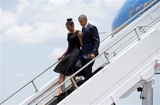 President Barack Obama and first lady Michelle Obama arrive on Air Force One, Friday, June 26, 2015, at Joint Base Charleston near Charleston, S.C. (AP Photo/Carolyn Kaster)