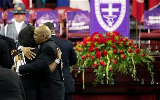 Mourners embrace next to the casket of Sen. Clementa Pinckney before his funeral service, Friday, June 26, 2015, in Charleston, S.C. (AP Photo/David Goldman)