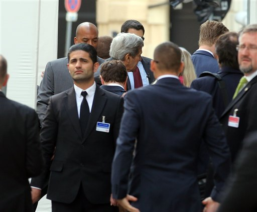 U.S. Secretary of State John Kerry, center, arrives at the Palais Coburg where closed-door nuclear talks with Iran take place in Vienna, Austria, Sunday, June 28, 2015. (AP Photo/Ronald Zak)