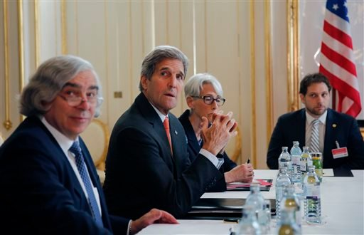 From left, U.S. Secretary of Energy Ernest Moniz, U.S. Secretary of State John Kerry and U.S. Under Secretary for Political Affairs Wendy Sherman, sit during a meeting with Iranian Foreign Minister Mohammad Javad Zarif at a hotel in Vienna, Austria, Sunda