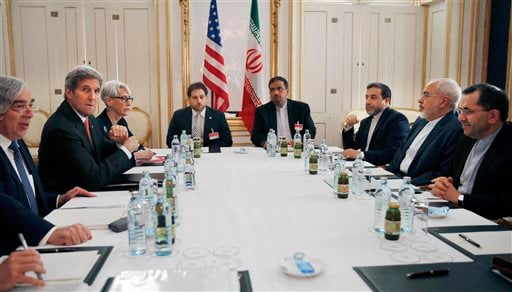 From left, U.S. Secretary of Energy Ernest Moniz, U.S. Secretary of State John Kerry and U.S. Under Secretary for Political Affairs Wendy Sherman, attend a meeting with Iranian Foreign Minister Mohammad Javad Zarif, second from right, at a hotel in Vienna