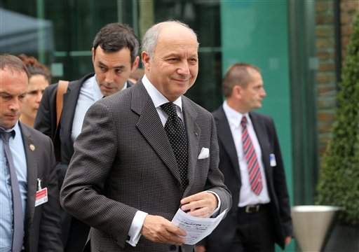 French Foreign Minister Laurent Fabius arrives at Palais Coburg where closed-door nuclear talks with Iran take place in Vienna, Austria, Saturday, June 27, 2015. Iran is making its red lines clear as talks on a final nuclear deal get underway. (AP Photo/R