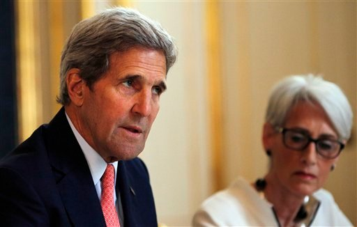 U.S. Secretary of State John Kerry, left, talks to reporters alongside U.S. Under Secretary for Political Affairs Wendy Sherman as they meet with the Iranian delegation at a hotel in Vienna, Austria, Saturday, June 27, 2015. After nearly a decade of inter