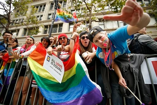 Crowds cheer on the performers during the 45th annual San Francisco Gay Pride parade Sunday, June 28, 2015, in San Francisco. A large turnout was expected for gay pride parades across the U.S. following the landmark Supreme Court ruling that said gay coup