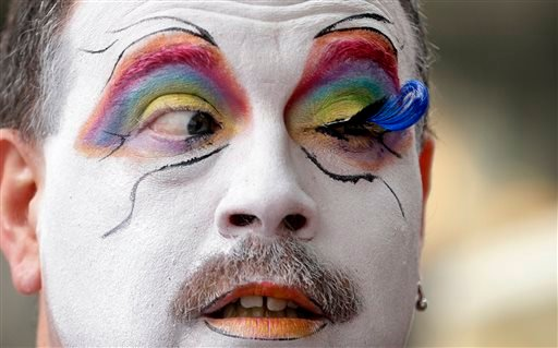 Brian Lavalle, also known as Sister Bebe Jeebus, a member of the Sisters of Perpetual Indulgence, looks across at his newly-applied eyelash as he prepares for the 41st annual Pride Parade Sunday, June 28, 2015, in Seattle. Large turnouts were expected for