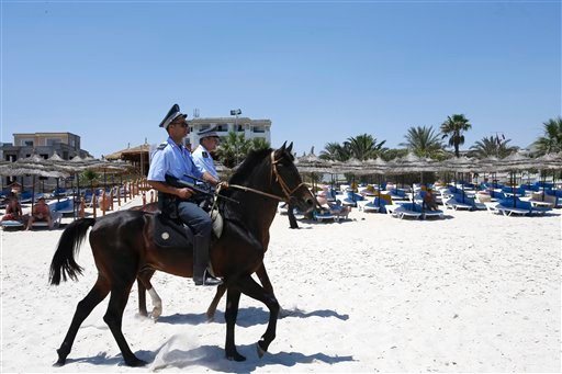 Mounted police officers patrol on the beach of Sousse, Tunisia, Sunday, June 28, 2015. Tunisia's top security official says 1,000 extra police are being deployed at tourist after Friday's attack. (AP Photo/Abdeljalil Bounhar)