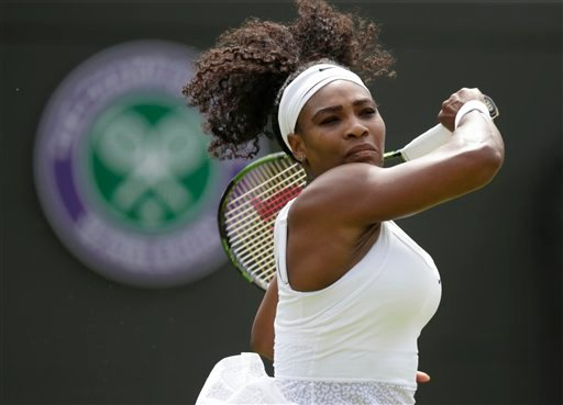 Serena Williams of the United States plays a return to Margarita Gasparyan of Russia during the women's singles first round match at the All England Lawn Tennis Championships in Wimbledon, London, Monday June 29, 2015. (AP Photo/Pavel Golovkin)