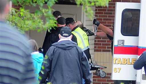 Prison escapee David Sweat, is wheeled in to Alice Hyde Medical Center, after being shot and captured Sunday, June 28, 2015, in Malone, N.Y. (Rob Fountain/The Press-Republican via AP)