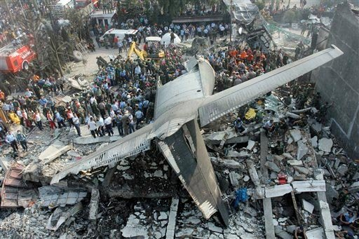 Rescuers search for victims at the site where an air force cargo plane crashed in Medan, North Sumatra, Indonesia, Tuesday, June 30, 2015.
