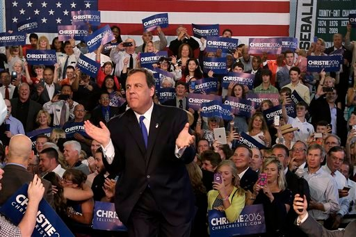 New Jersey Gov. Chris Christie takes the podium before speaking to supporters during an event announcing he will seek the Republican nomination for president, Tuesday, June 30, 2015, at Livingston High School in Livingston, N.J. (AP Photo/Mel Evans)