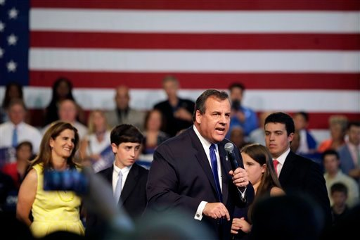 New Jersey Gov. Chris Christie, accompanied by his family, speaks to supporters during an event announcing he will seek the Republican nomination for president, Tuesday, June 30, 2015, at Livingston High School in Livingston, N.J. (AP Photo/Mel Evans)