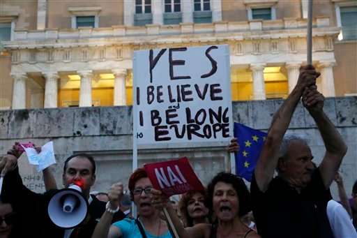 Demonstrators shout slogans during a rally organized by supporters of the YES vote for the upcoming referendum in front of the Greek Parliament in Athens, Tuesday, June 30, 2015.