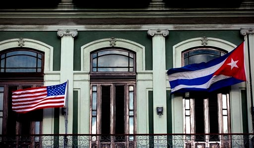 In this Jan. 19, 2015 file photo, a Cuban and American flag wave from the balcony of the Hotel Saratoga in Havana. (AP Photo/Ramon Espinosa, File)