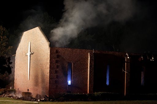 Smoke rises from Mount Zion African Methodist Episcopal church late Tuesday, June 30, 2015, in Greeleyville, S.C., which caught fire Tuesday.