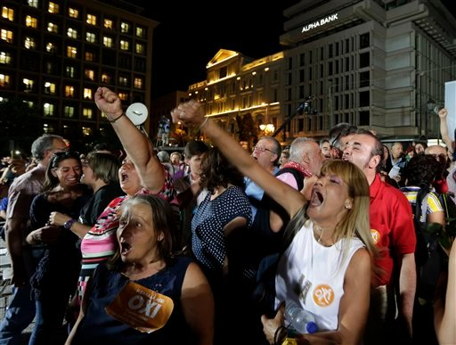 Supporters of the No vote react after the first results of the referendum at Klafthmonos square in Athens, Sunday, July 5, 2015. Greece faced an uncharted future as officials counted the results of a referendum Sunday on whether to accept creditors' deman