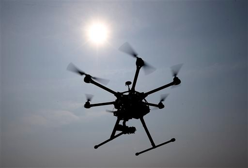 In this June 11, 2015, photo, a hexacopter drone is flown by Doug Bennett, senior technician and operator for Intelligent UAS, during a drone demonstration at a farm and winery on potential use for board members of the National Corn Growers in Cordova, Md