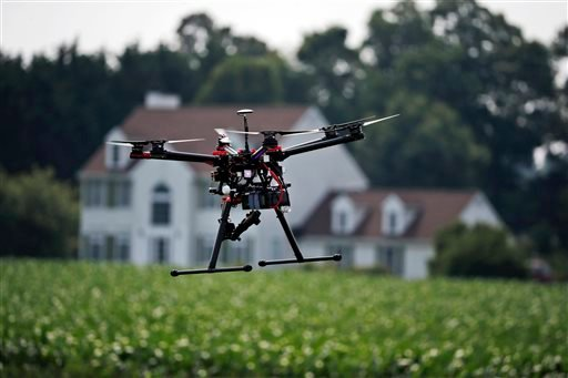 In this June 11, 2015, photo, a hexacopter drone is flown by Intelligent UAS, during a drone demonstration at a farm and winery on potential use for board members of the National Corn Growers in Cordova, Md. The small, relatively inexpensive unmanned aeri